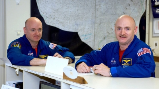NASA astronaut Mark Kelly, right, stayed on the ground, while his brother Scott Kelly spent 340 days on the International Space Station. Researchers are noting changes in biological markers because of the time in zero gravity. (NASA/Associated Press)